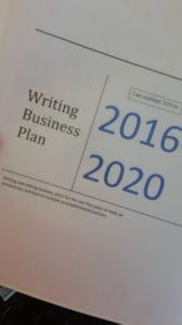 The cover of my fancy writing business plan, which I got in a fancy report folder.