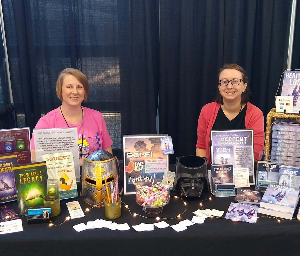Kylie Betzner and S.M. Wright at Con booth.